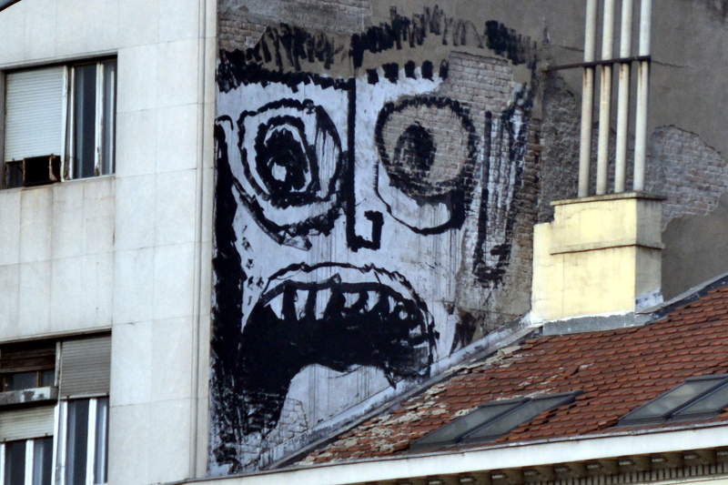 Street art high-up above roofline