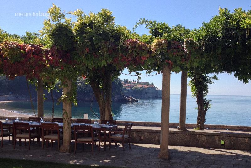 Dining at Villa Milocer w/ Sveti Stefan in view - meanderbug
