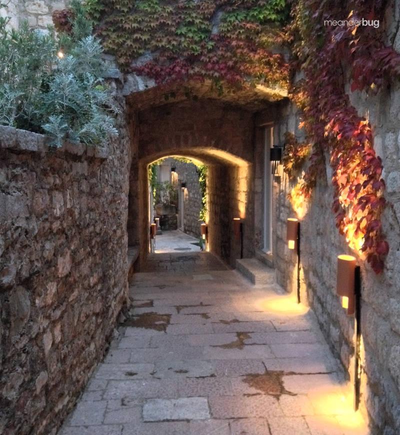 Inside Sveti Stefan at dusk - meanderbug