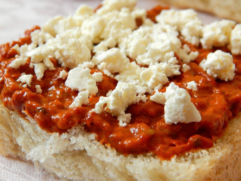 Ajvar and cheese on bread - a Balkan fave