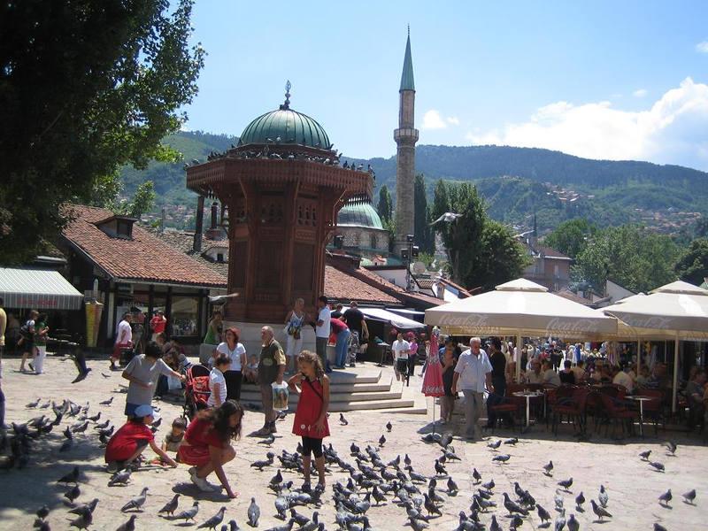 Kids feeding the birds in Sarajevo Old Town