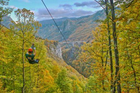 Zip lining across Tara Canyon - longest zipline in Montenegro