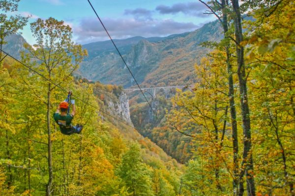 Zip lining across Tara Canyon - longest zipline in Montenegro