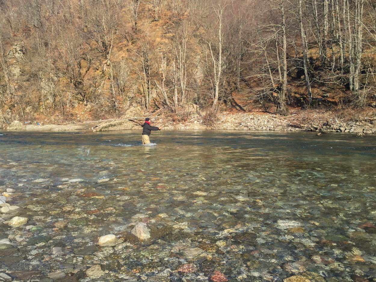 An average Joe fly fishing in Montenegro on a wintry day