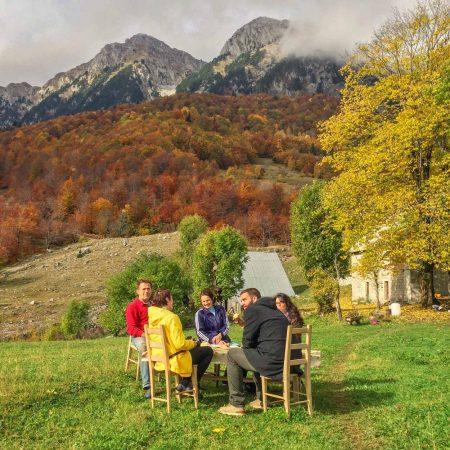 Enjoying fresh cheeses and bread on the Dulovic Farm Stay in Lipovo