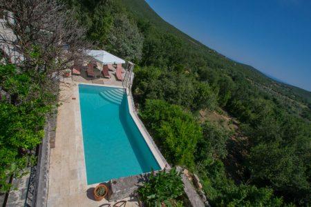 A swimming pool at Klinci Village Resort on Lustica in Montenegro