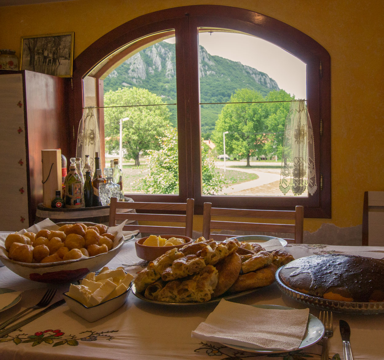 Organic traditional foods with mountain view through window at Montenegro farm stay