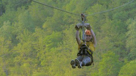 Woman flying over tara canyon on zipline