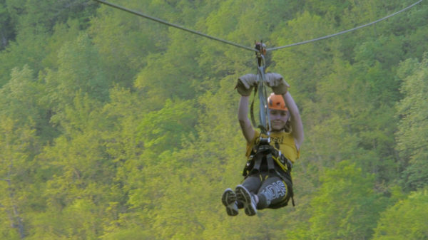 Woman flying over tara canyon on zipline